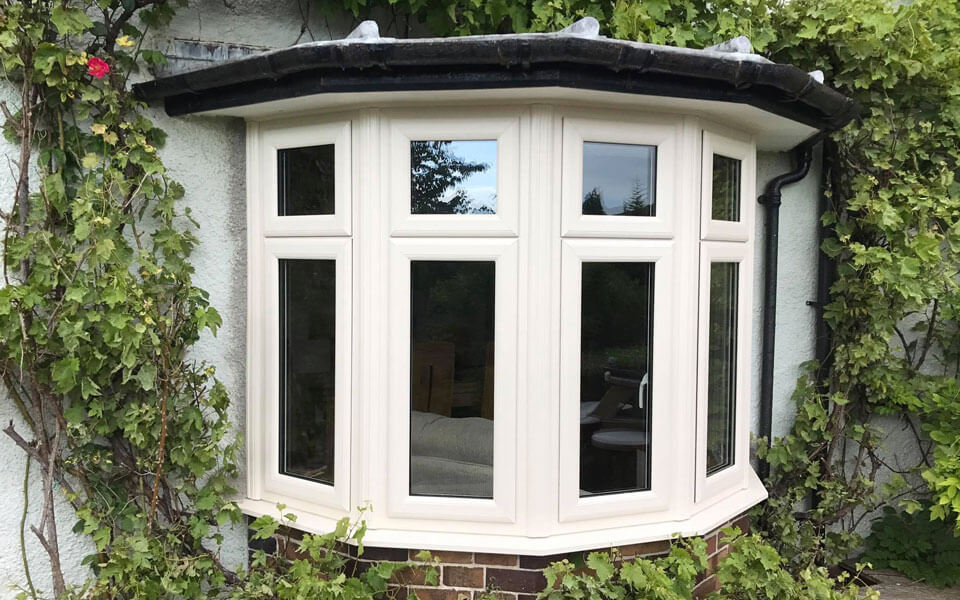 Cream uPVC bow window installation