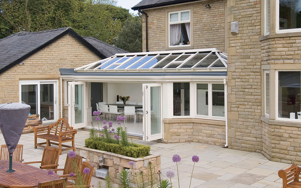 Cream uPVC orangery with a glass