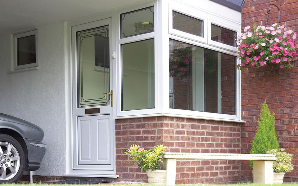 White uPVC entrance door and veranda