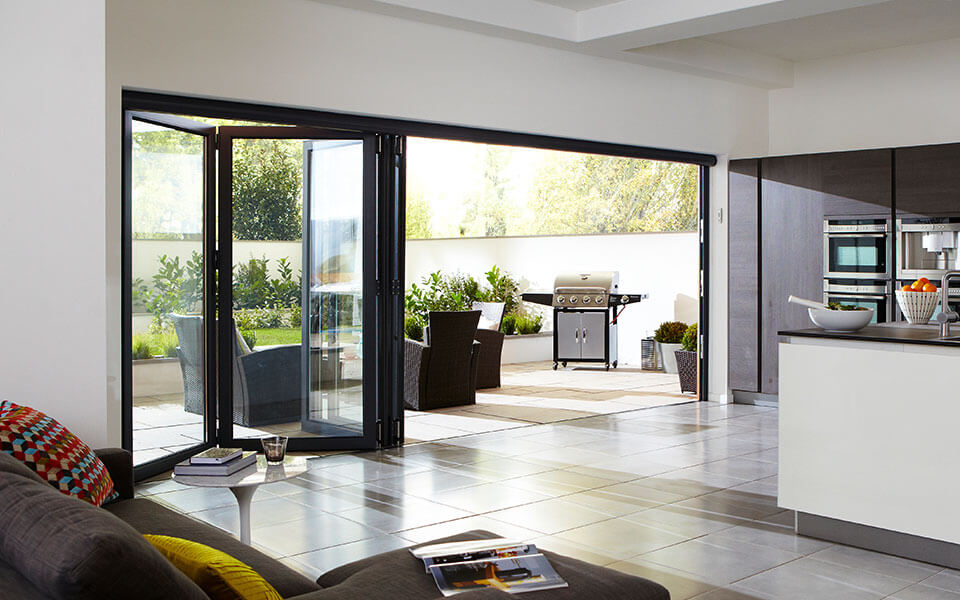 Black aluminium bifold door in a kitchen extension