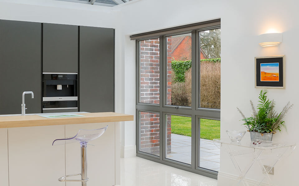 Large grey flush sash aluminium windows interior view