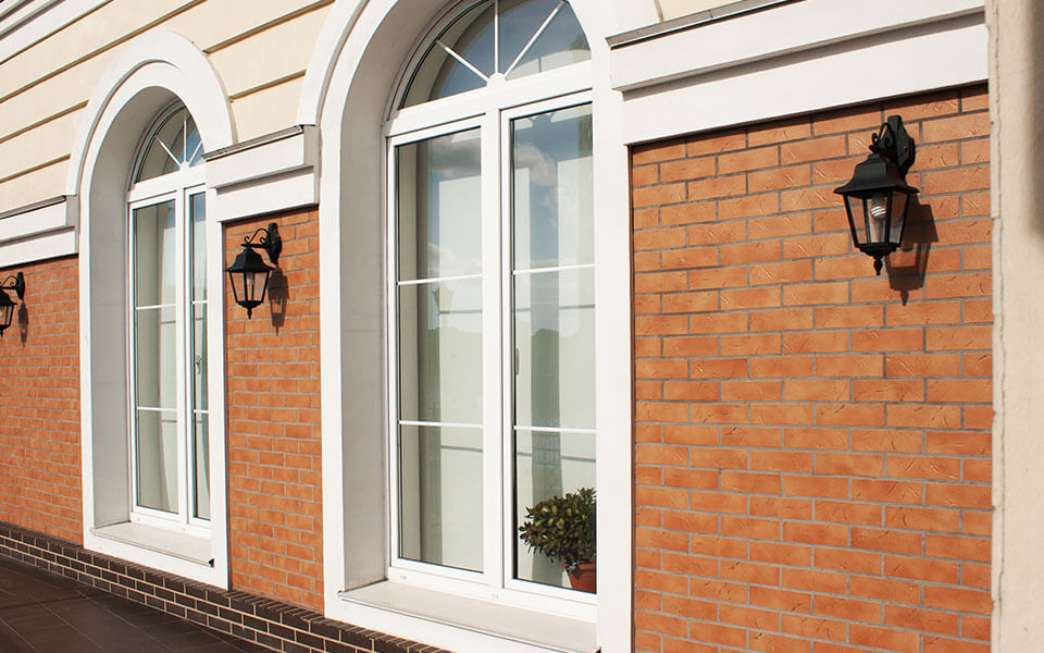 Large white uPVC tilt and turn windows