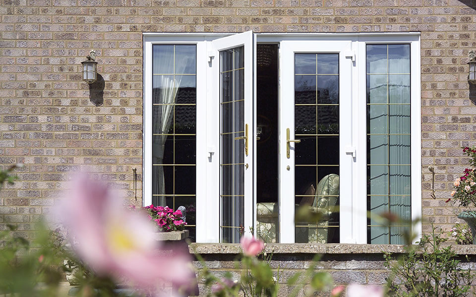 White uPVC french door with leaded windows