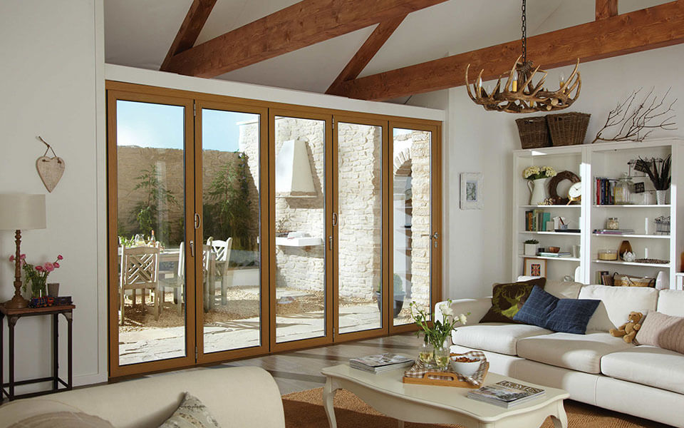 Oak effect aluminium bifold door installation