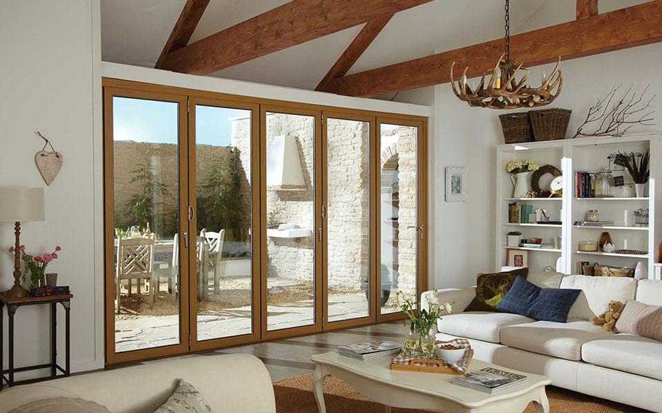 Oak effect aluminium bifold door installation