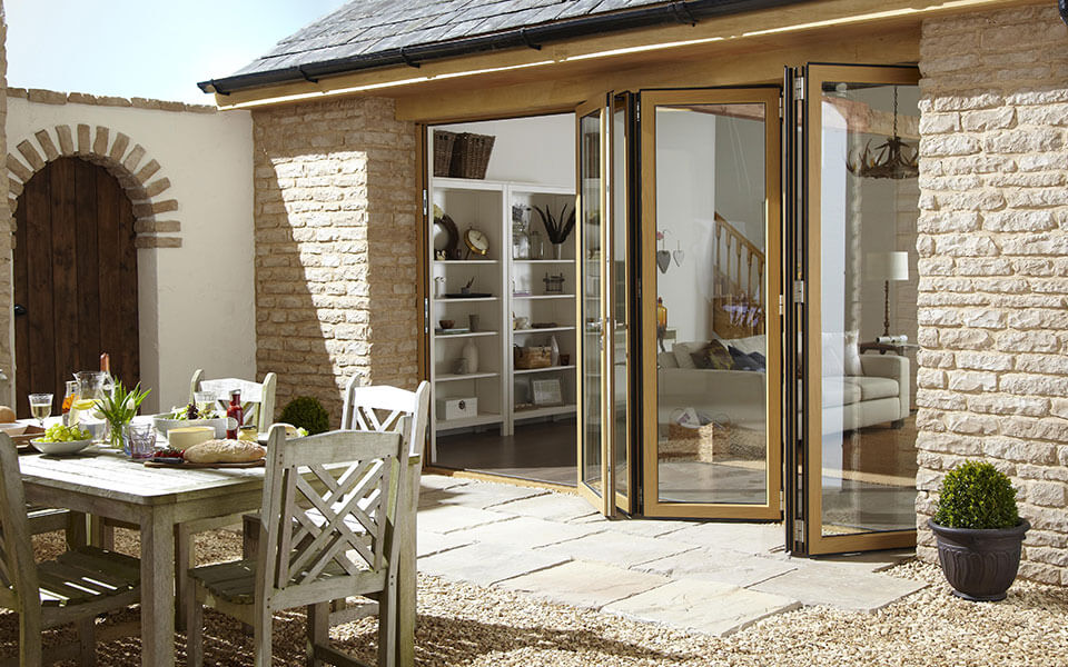 Irish oak effect aluminium bifold door