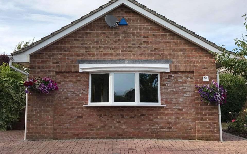 Small white uPVC bow window