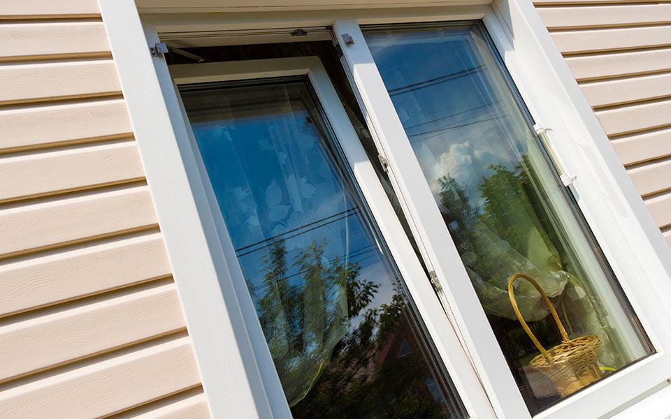 Open white uPVC tilt and turn window