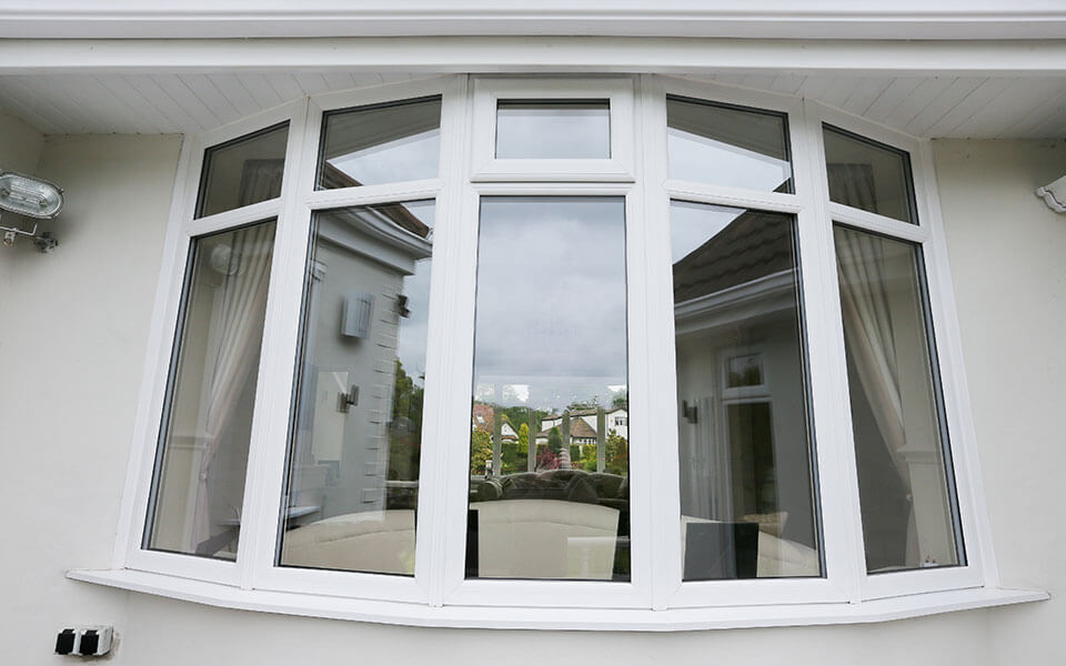 White uPVC bow window close up