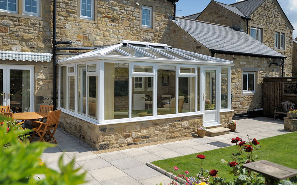 White uPVC gerogian conservatory with a glass roof