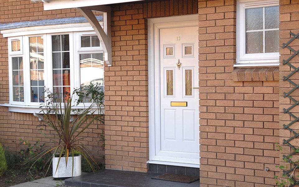 White uPVC residential entrance door